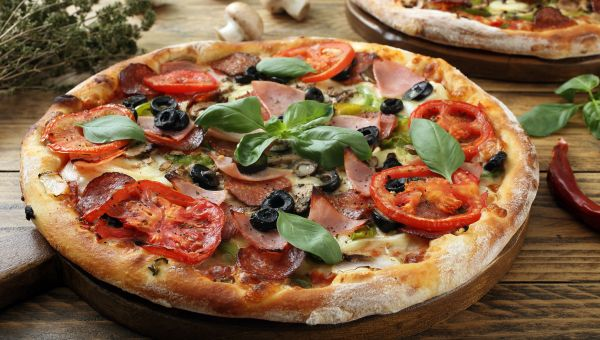 Pizza on Rustic Wooden Table