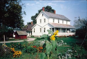 Amish Acres Historic Farm with flowers in front of building