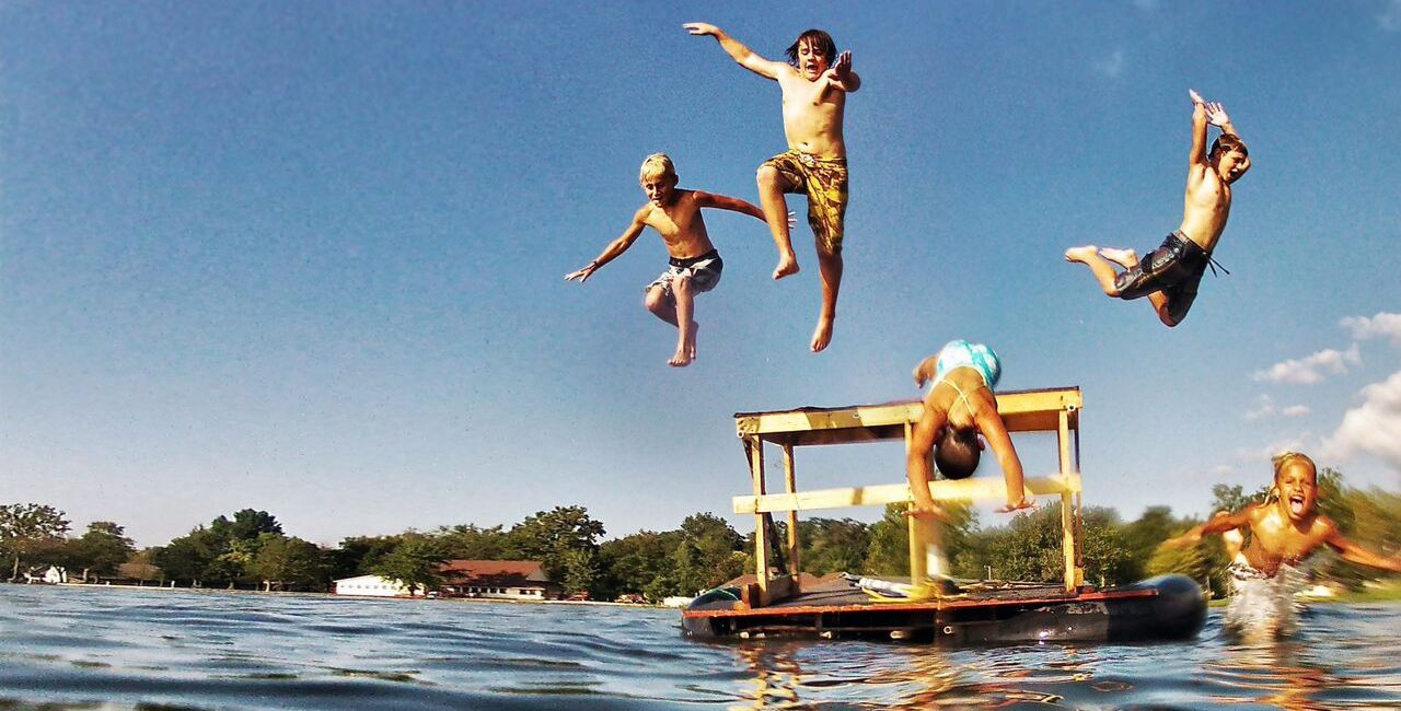 Boys Jumping in Lake