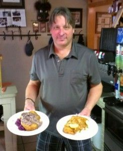 Chef Werner Moser serves up two schnitzel dishes at his restaurant.