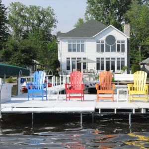 Colorful deck chairs on a dock on Kosciusko County, Indiana