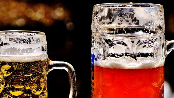 Two glass beer mugs