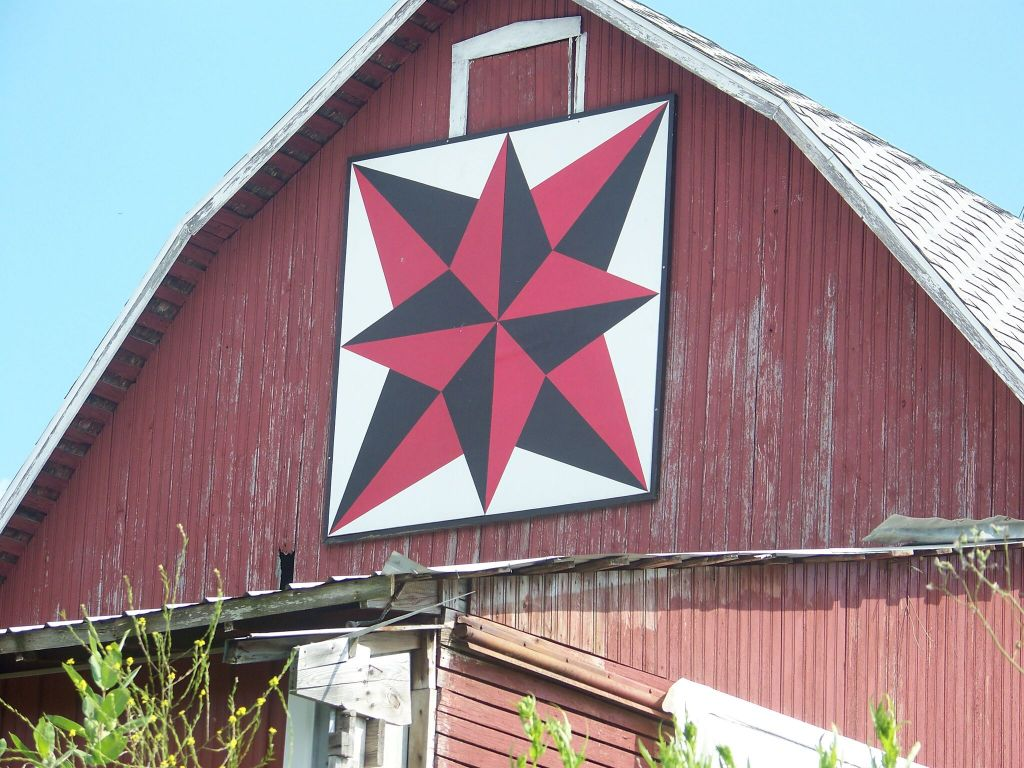 A barn quilt mural painted on a barn in Northern Indiana.