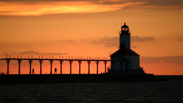 The sun sets behind the Michigan City lighthouse.